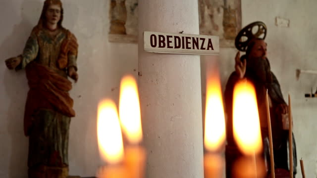 candles inside a church in calvi, corsica - calvi stock videos and b-roll footage