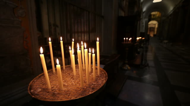 Candles inside a church in Rome