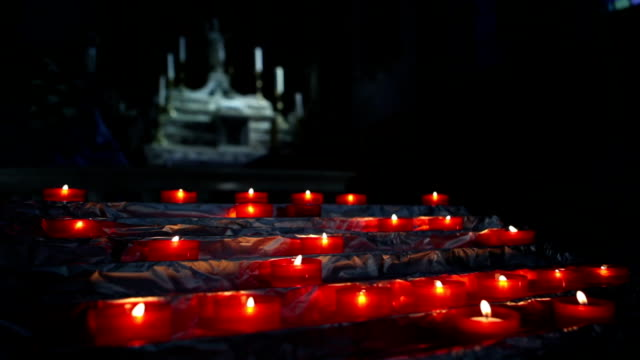 candles inside a church - calvi stock videos and b-roll footage