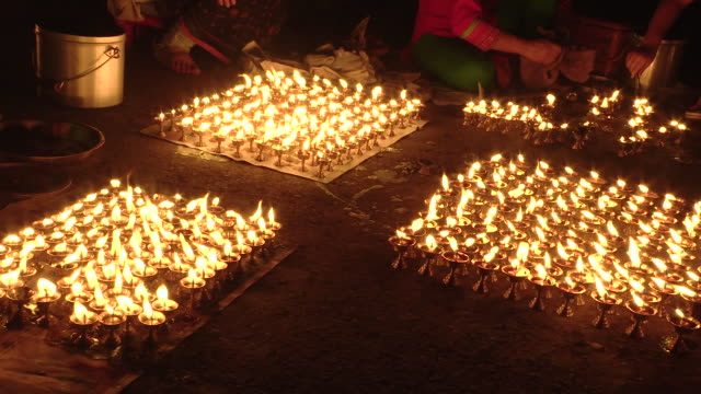 candles lit for bunga dyah jatra in nepal - rispetto video stock e b–roll