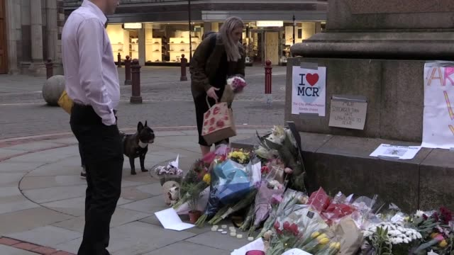 Candles messages and flowers left around Manchester City Centre following Monday's terror attack Dusk shots of people lighting candles and leaving...
