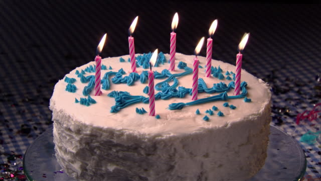 cu, candles on birthday cake being blown  - birthday cake stock videos & royalty-free footage