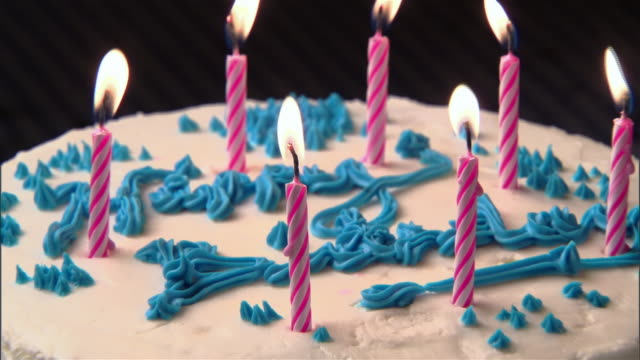 cu, zo, candles on birthday cake being blown  - birthday cake stock videos & royalty-free footage