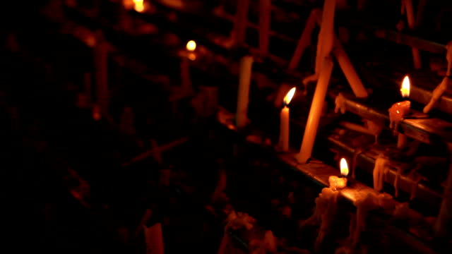 candles placed in a row. - gothic stock videos & royalty-free footage
