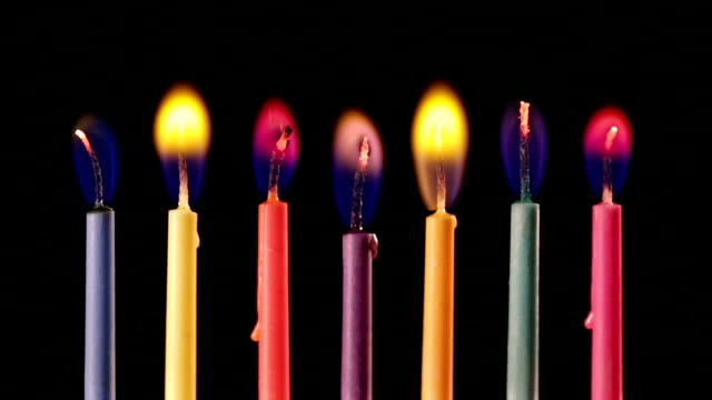 Candles with coloured flames