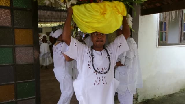 vídeos de stock, filmes e b-roll de candomble is an afro syncretic religion that worships gods associated with nature or orixas. in this ceremony the goddess oxum and iemanja are... - afro