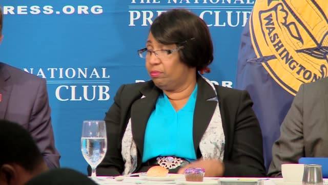 Candy Carson listening to husband Ben Carson give speech at National Press Club in Washington DC
