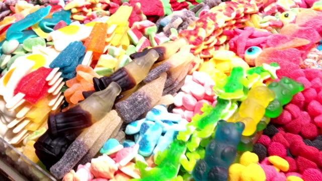 candy shop in la boqueira market, barcelona - confectionery stock videos & royalty-free footage