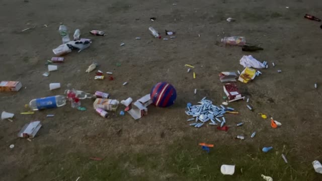 canisters and balloons lie on the grass following a large gathering of youngsters on june 24 in brighton. - eddie large stock videos & royalty-free footage