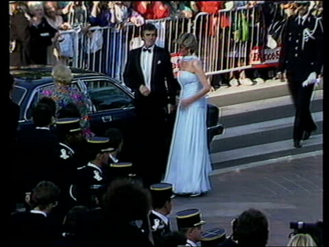 cannes: ext diana, in long strapless dress, and prince charles, prince of wales at the cannes film festival - princess stock videos & royalty-free footage