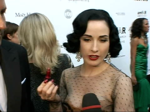 amfar charity auction dita von teese interview sot as stands next john dempsey on her 'liptease' performance / on strip tease as the ultimate safe... - corset stock videos & royalty-free footage