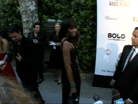 stockvideo's en b-roll-footage met amfar charity auction naomi campbell posing for photocall and speaking to press sot - naomi campbell