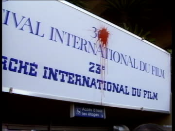 vídeos de stock, filmes e b-roll de cannes: ext av rows of crs riot police outside new film festival building new film festival palais and crowds outside bv woman remonstrating with a... - monty python