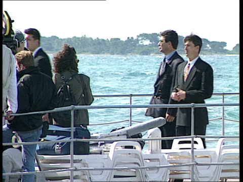 general views and david aukin interview tomorrow never dies promo on pier / people dressed as beavis butthead at promo press scrum for angie eberhardt - tomorrow never dies stock videos and b-roll footage