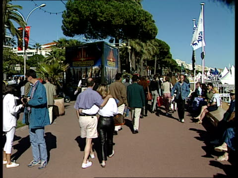 general views gvs beauty contestants parading thru streets gvs posters on hoardings inc hercules / men in black / le cinquieme element cannes 50 eme... - festival poster stock videos & royalty-free footage