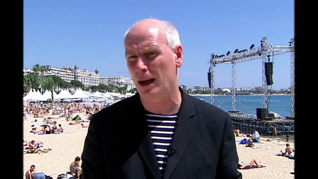 ian curtis biopic takes cannes by storm reporter to camera - 伝記映画点の映像素材/bロール