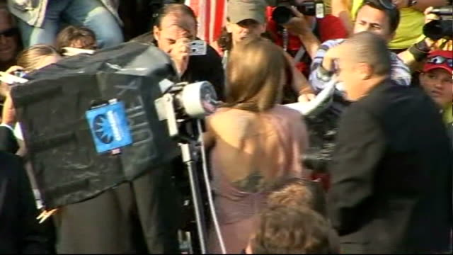 'inglourious basterds' premiere brad pitt and angelina jolie along on red carpet / back views pitt and jolie signing autographs / quentin tarantino... - brad pitt actor stock videos and b-roll footage