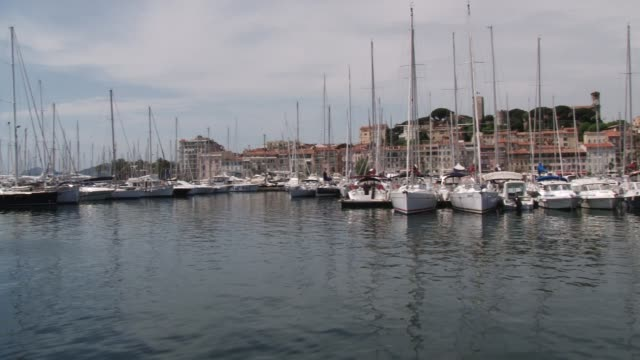 cannes harbour yachts on may 25, 2011 in cannes, france - cote d'azur stock videos & royalty-free footage
