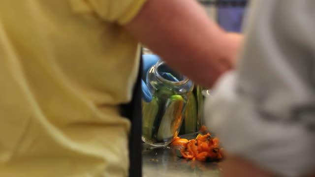 vídeos y material grabado en eventos de stock de canning encurtidos. de decapado los pepinos. - disposable gloves
