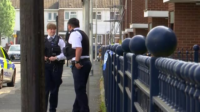 Two men arrested ENGLAND London Newham Canning Town EXT Various forensic investigators and police officers at property