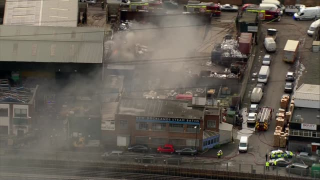 canning town scrapyard fire aerials canning town scrapyard fire aerials england london canning town view / aerial scrapyard fire with black smoke and... - canning stock videos & royalty-free footage