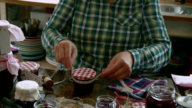 canning various homemade jams in jars - canning stock videos & royalty-free footage