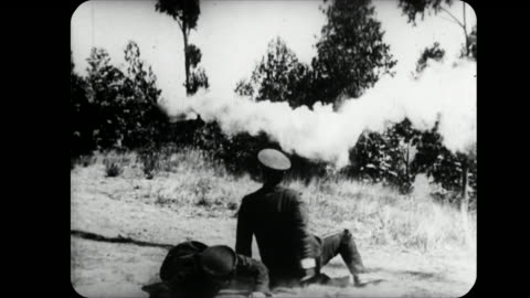1914 cannon ball knocks man down cliff before exploding - moving down stock videos & royalty-free footage