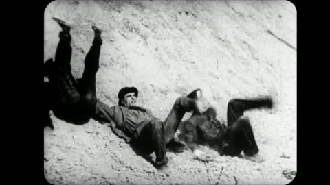 stockvideo's en b-roll-footage met 1914 cannon ball knocks police off cliff onto criminal as couple embrace - klif