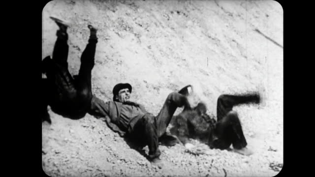 1914 cannon ball knocks police off cliff onto criminal as couple embrace - cliff stock videos & royalty-free footage