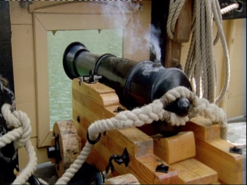 Cannon being fired on board replica of HMS Endeavour.