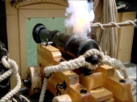 cannon being lit on board replica of hms endeavour. - ecuador stock videos and b-roll footage