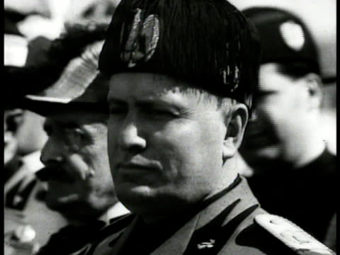 stockvideo's en b-roll-footage met cannon firing cu fascist dictator benito mussolini in fringed hat ws italian warship moving on water implied mediterranean ha xws soldiers walking... - benito mussolini