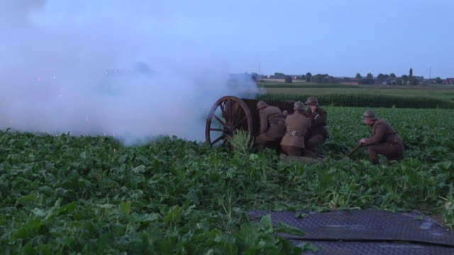 a cannon is fired to mark the moment 100 years ago when the battle of passchendaele began - artiglieria video stock e b–roll