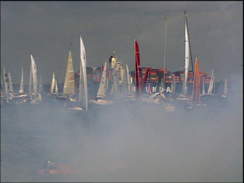 cannon is fired to start yacht racing at cowes isle of wight - menschlicher arm stock-videos und b-roll-filmmaterial