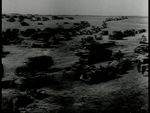cannon large artillery pointed up firing. xws german nazi trucks tanks assemble on field. tanks moving in line through village. wwii world war ii. - tank stock videos & royalty-free footage