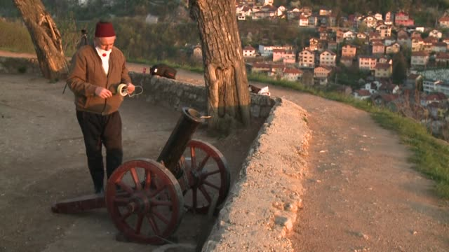 cannon shot and calls to prayer mark the beginning of ramadan in sarajevo - cannon stock videos & royalty-free footage