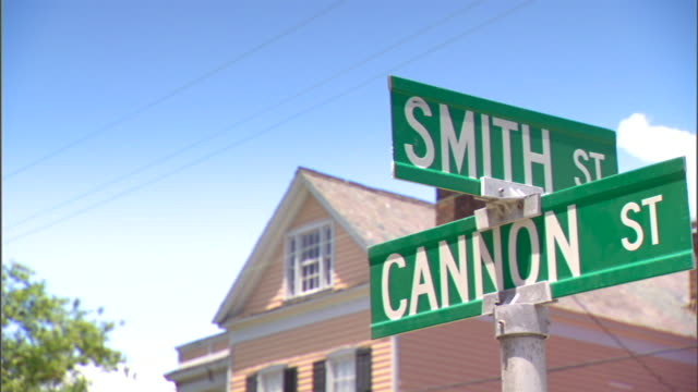 ms cannon smith street intersection signs on top of pole house front roof bg 1950s little league allstars segregation children discrimination... - youth baseball and softball league stock videos and b-roll footage