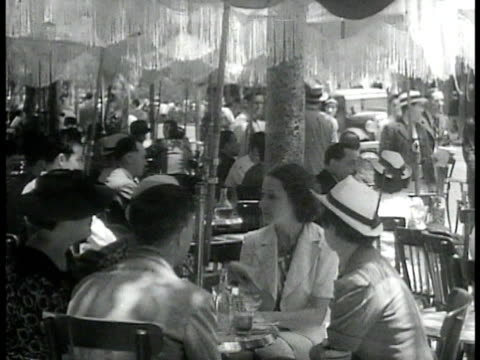 stockvideo's en b-roll-footage met cannons lined up against wall looking over city possibly algiers ws row of french people sitting at outdoor cafe talking eating waiters ws french... - 1937