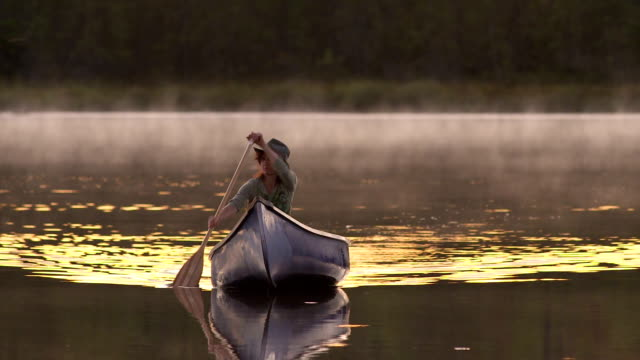canoe approching - canoeing stock videos and b-roll footage