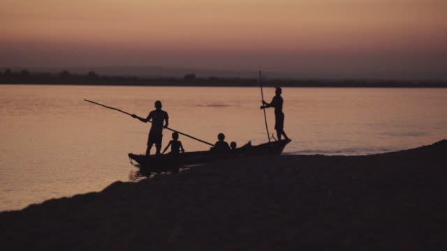 canoe at sunset - village stock videos & royalty-free footage
