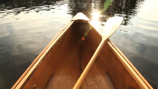 POV Canoe bow with paddle on lake, Ashburnham, Massachusetts, USA