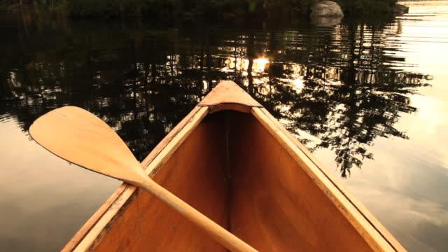 pov canoe bow with paddle on lake, ashburnham, massachusetts, usa - oar stock videos & royalty-free footage