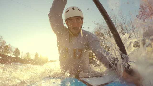POV Canoe competitor paddling on the slalom course in sunshine