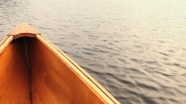 POV Canoe floating on lake, Ashburnham, Massachusetts, USA