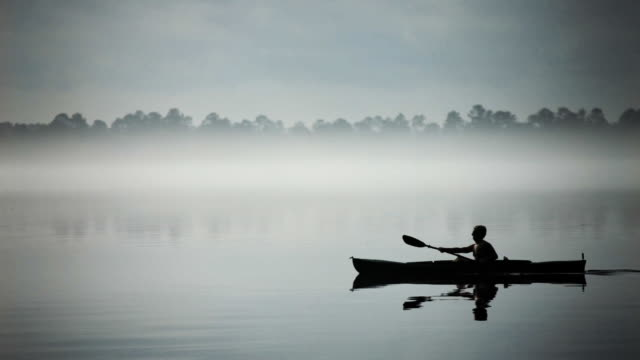 canoe in silhouette - rowing boat stock videos & royalty-free footage