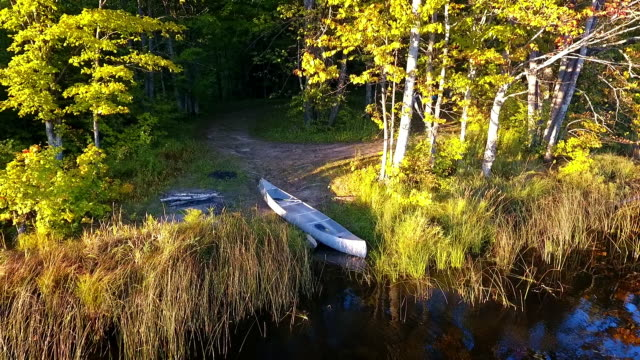Canoe on beac on remote lake in the Upper Peninsula of Michigan from above