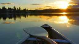 Canoe on Lake, Nature Adventure, Dusk Sunset on Still Ocean Water