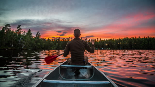 canoeing at sunrise - canoeing stock videos and b-roll footage