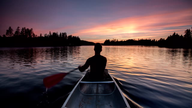 canoeing at sunset - canoe stock videos & royalty-free footage