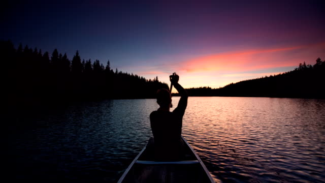 canoeing at sunset - canoeing stock videos and b-roll footage